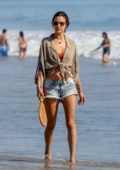 Alessandra Ambrosio plays Paddle Ball while enjoying a day at the beach with her kids in Santa Monica, California
