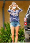 Alessandra Ambrosio puts on her face mask while visiting a friend's house in Malibu, California