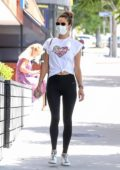 Alessandra Ambrosio rocks a white top and black leggings as she arrives a for Pilates class in Brentwood, California