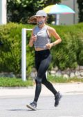 Alessandra Ambrosio sports a grey top and black leggings as she goes for a run in Brentwood, California