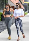 Alessandra Ambrosio sports patterned leggings and white top as she heads to the gym with a friend in Brentwood, California
