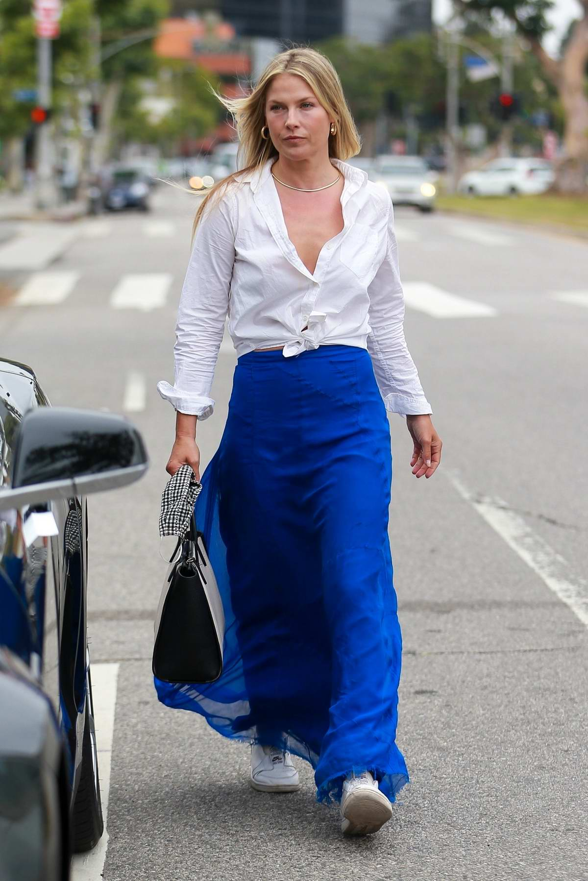 Ali Larter looks great in a long blue skirt paired with a white shirt as she visits a friend in Hollywood, California