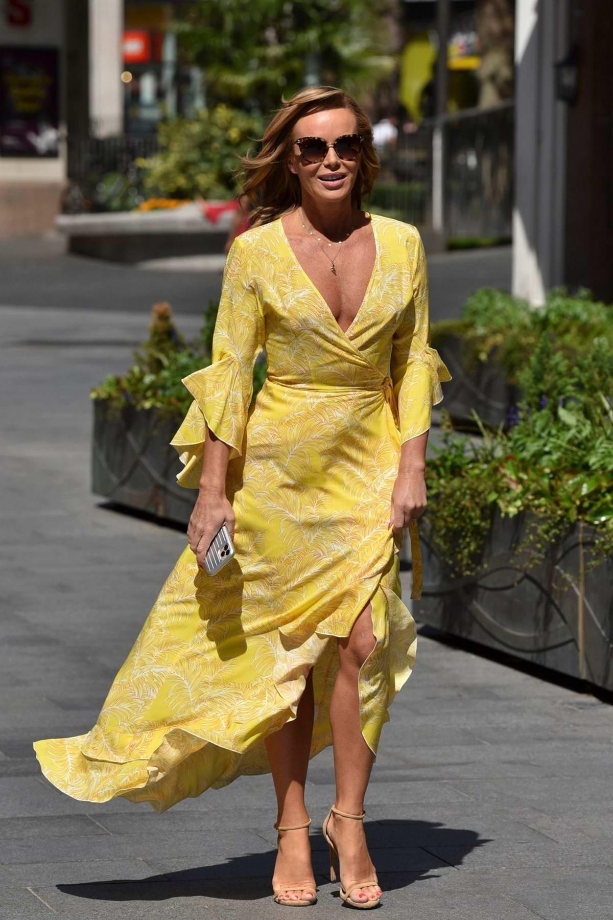 Amanda Holden looks striking in a yellow dress as she leaves Global Radio Studio in London, UK