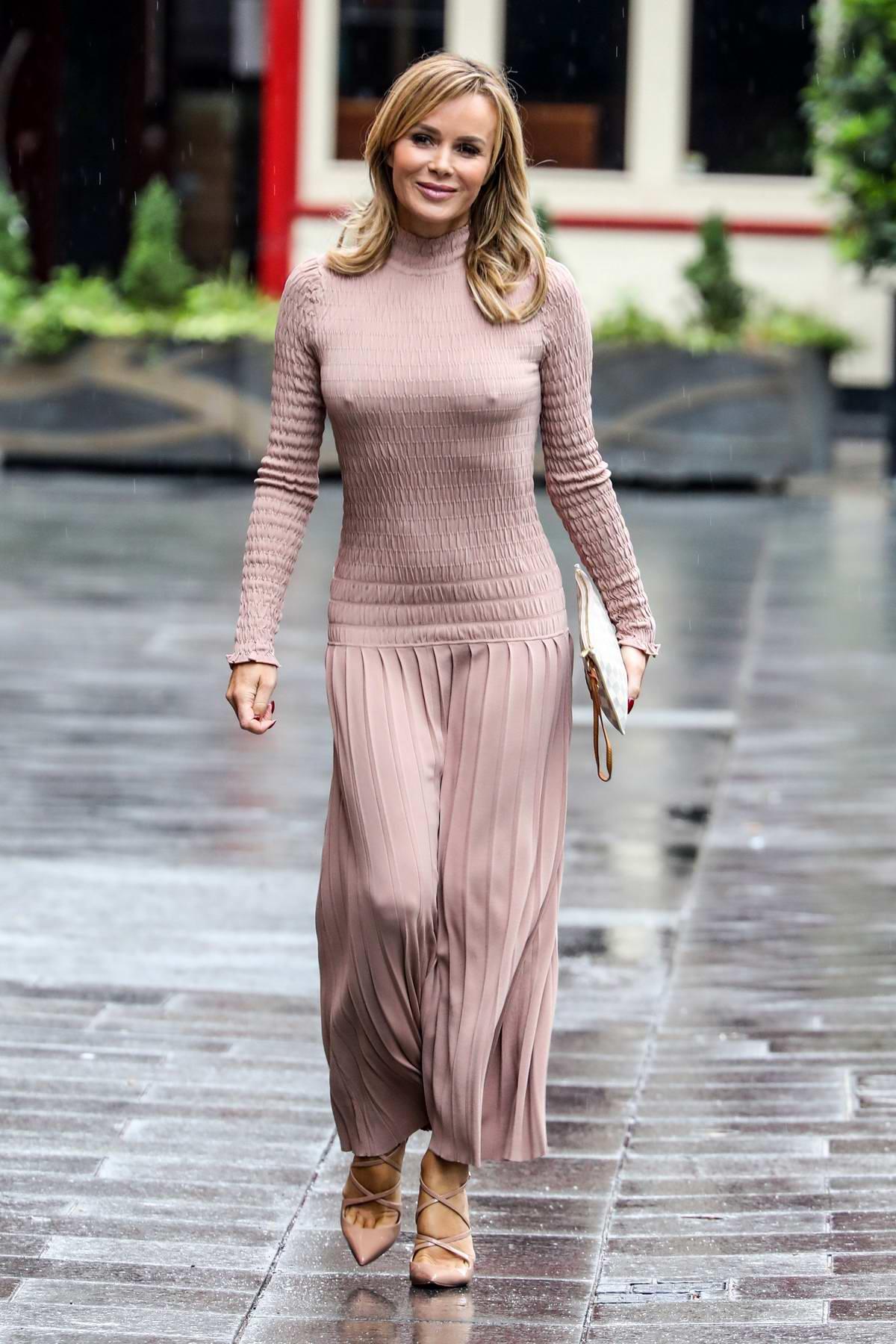 Amanda Holden seen wearing a form-fitting light mauve dress she leaves the Global Radio Studios in London, UK