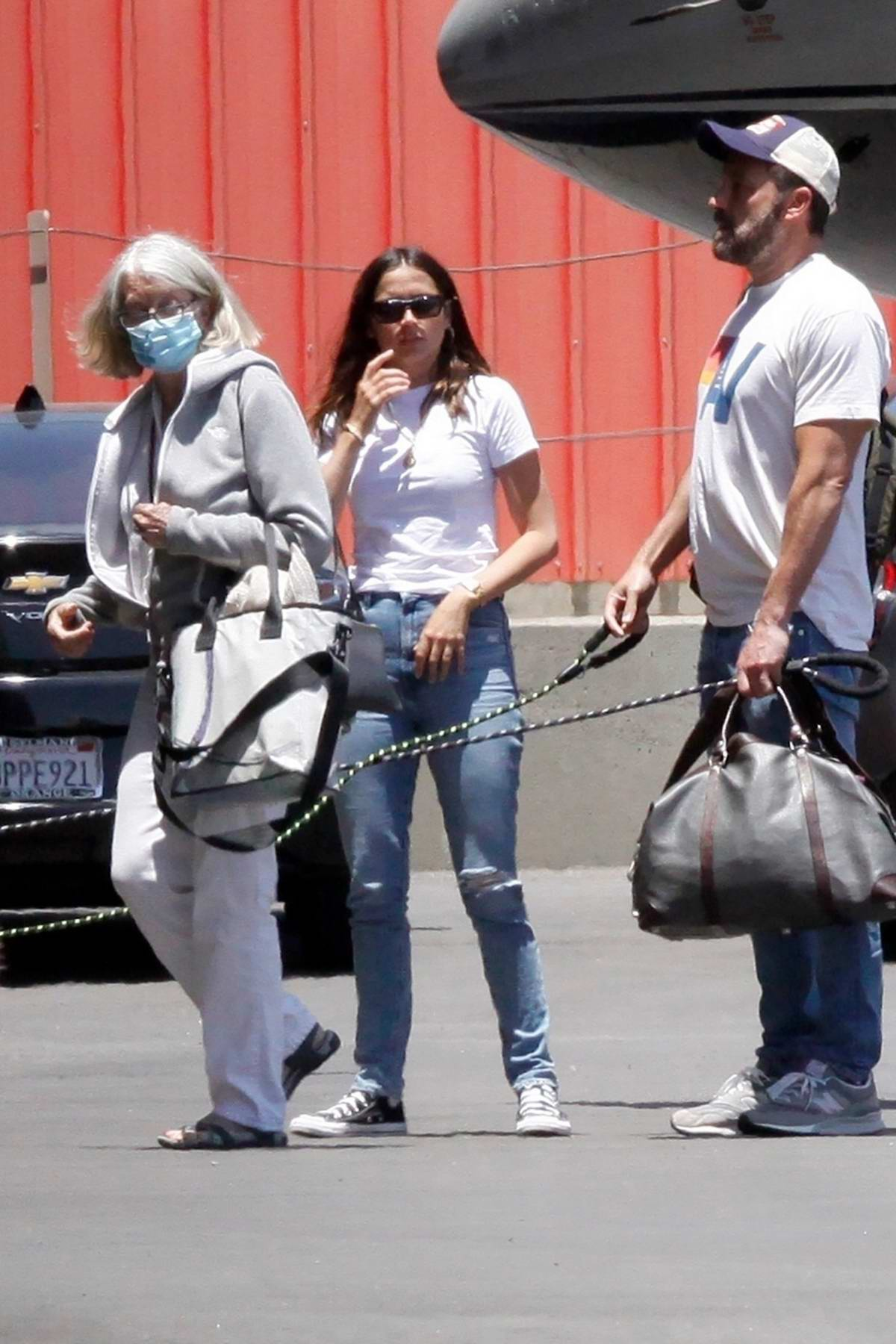 Ana de Armas seen with Ben Affleck and his mom as they touches down on a private jet in Los Angeles