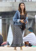 Ana de Armas wears a monochrome dress with a denim jacket while enjoying a walk along the beach with a friend in Venice, California