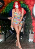 Anastasia Karanikolaou sports bright red hair as she arrives to the gay pride party at 40 Love in West Hollywood, California