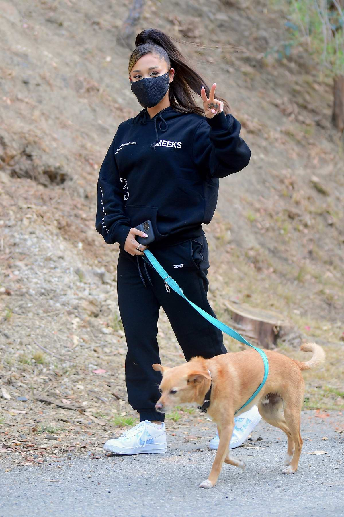 Ariana Grande keeps it comfy in black sweatsuit while out for a hike in Los Angeles