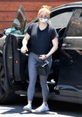 Ariel Winter sports a black top and grey leggings as she takes her dog to the Vet in Studio City, California