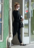 Ariel Winter sports all-black while visiting a skin care clinic with a friend in West Hollywood, California