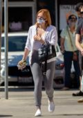 Ariel Winter wears a white top and a jacket with grey leggings while running errands in Los Angeles