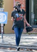 Ashley Benson wears a bandana mask as she stops to grab her morning coffee at Alfred's in West Hollywood, California