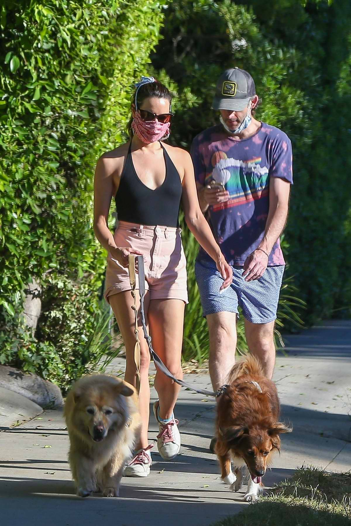 Aubrey Plaza and Jeff Baena take their two dogs for their daily walk in Los Feliz, California