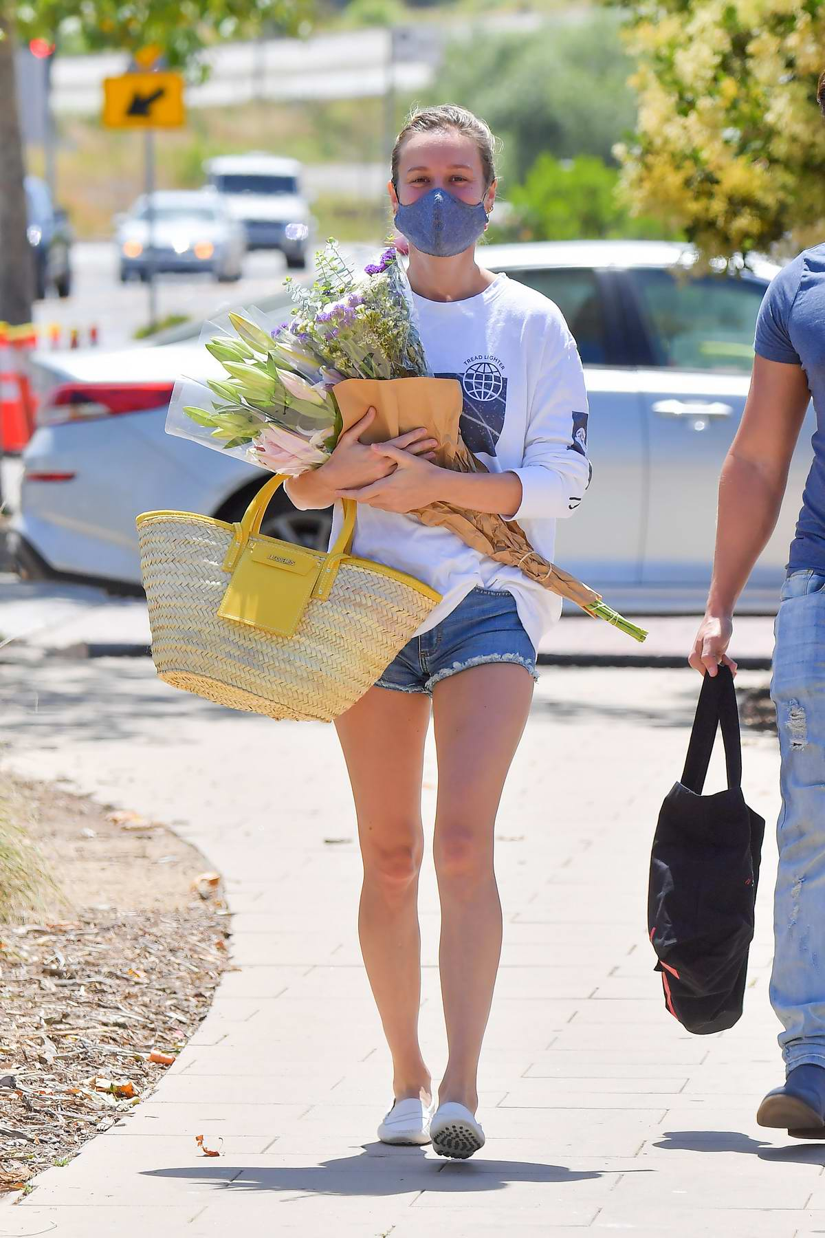 Brie Larson and boyfriend Elijah Allan-Blitz shop for flowers at a farmer's market in Malibu, California