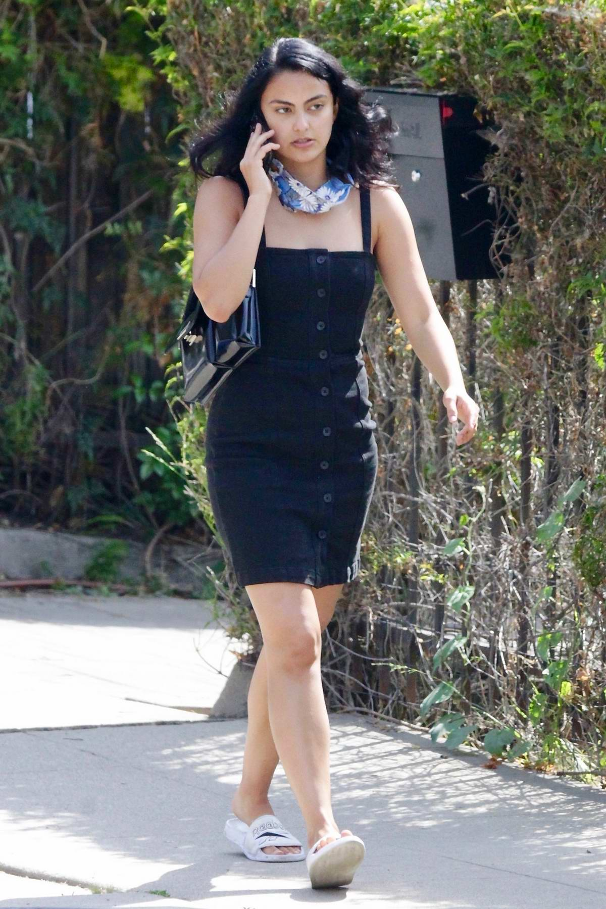Camila Mendes looks great in a button-down denim dress while out for a coffee run in Los Angeles