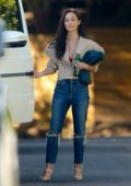 Cara Santana heads out from a friend's house looking chic in Los Angeles