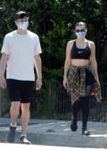 Charli XCX and boyfriend Huck Kwong seen wearing face masks while out for a walk in Los Angeles