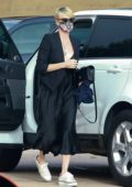 Charlize Theron looks great in all-black ensemble as she arrives for dinner with her kids at Nobu in Malibu, California