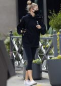 Charlotte McKinney sports a mask with a hoodie and leggings while making a coffee run in Brentwood, California