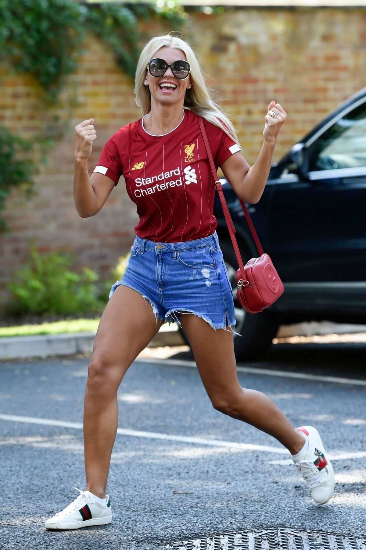 Christine McGuinness looks ecstatic as she celebrates Liverpool FC winning the EPL for the first time in 30 years, Cheshire, UK