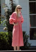 Dakota Fanning spotted in a red gingham dress while she gets some furniture delivered to her new home in Los Angeles