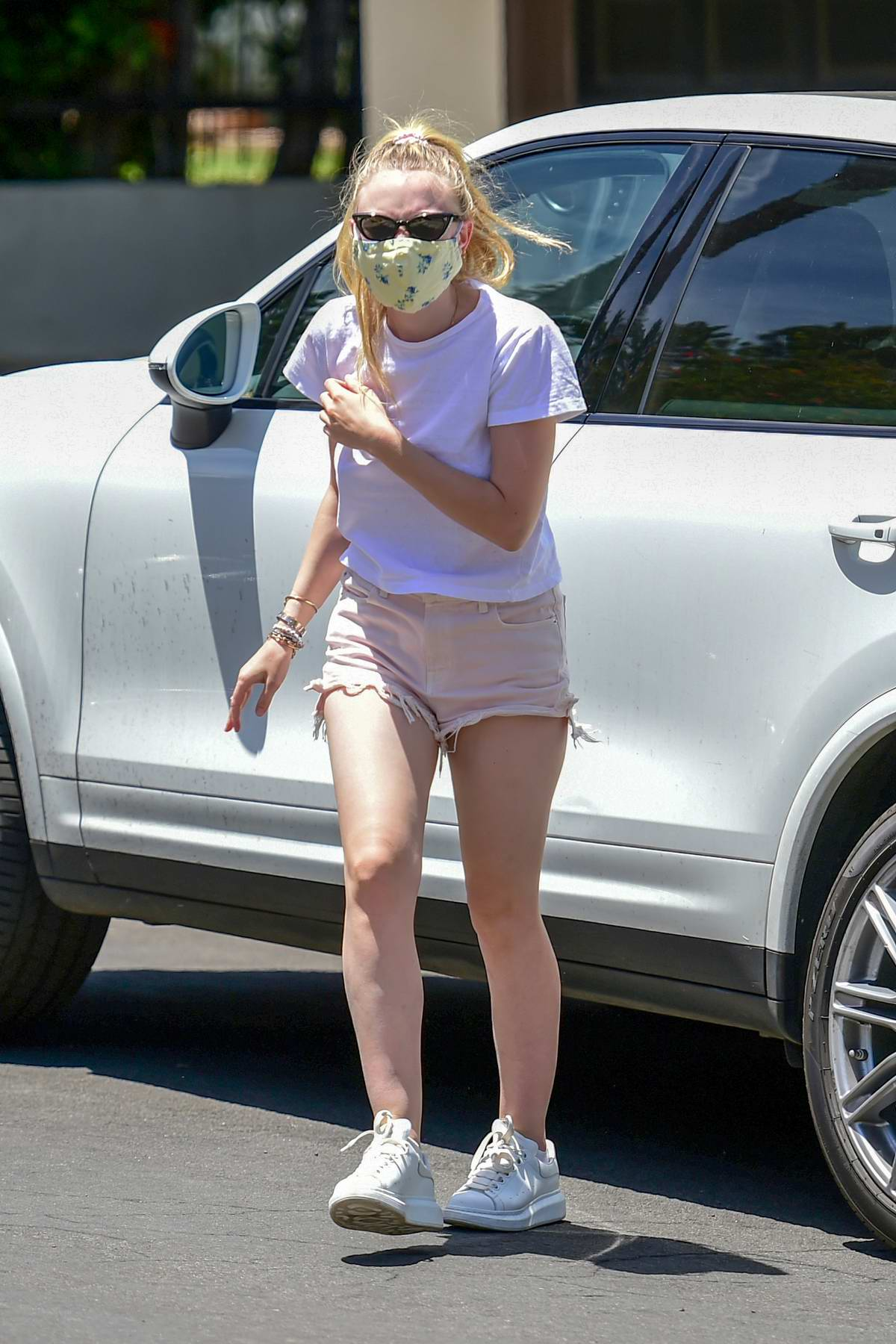 Dakota Fanning wears a white tee and denim cut-offs as she steps out in Los Angeles