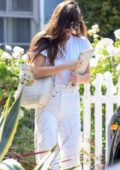 Dakota Johnson dons all-white as she leaves a friend's home in Los Angeles
