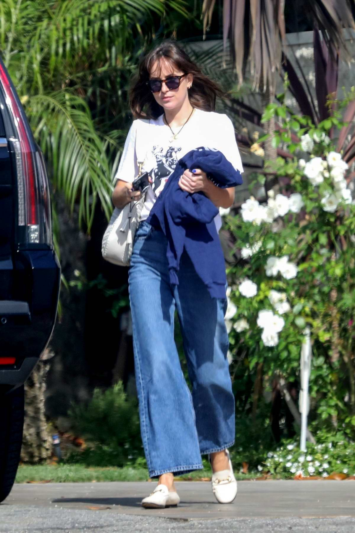 Dakota Johnson visits a friend for a beach side lunch in Malibu, California