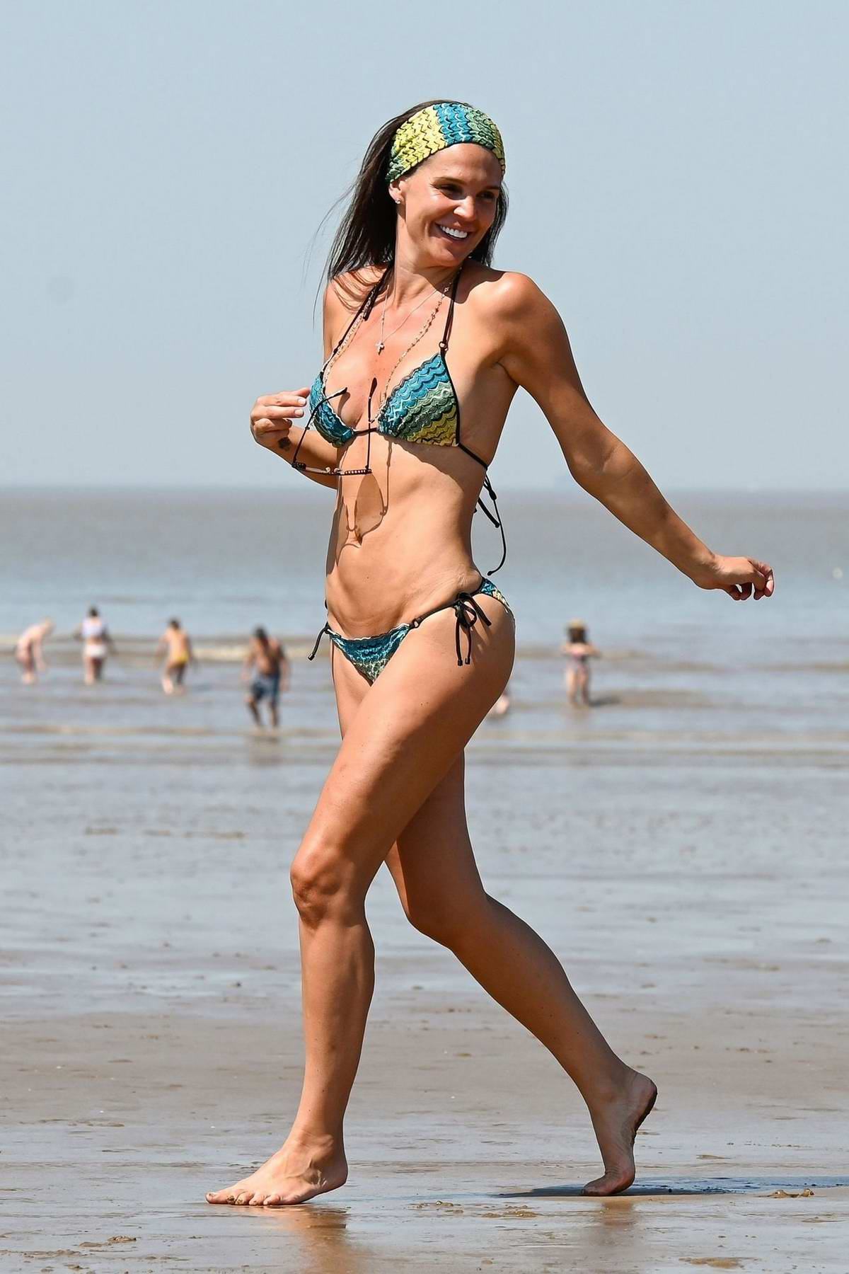 Danielle Lloyd shows off her bikini body on the hottest day of the year at Weston-super-Mare beach, UK