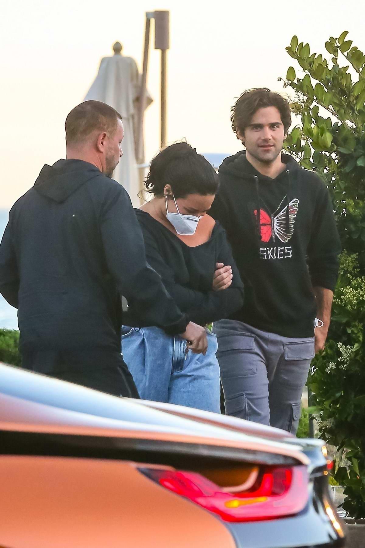 Demi Lovato and boyfriend Max Ehrich make a quick exit after dinner at Nobu in Malibu, California