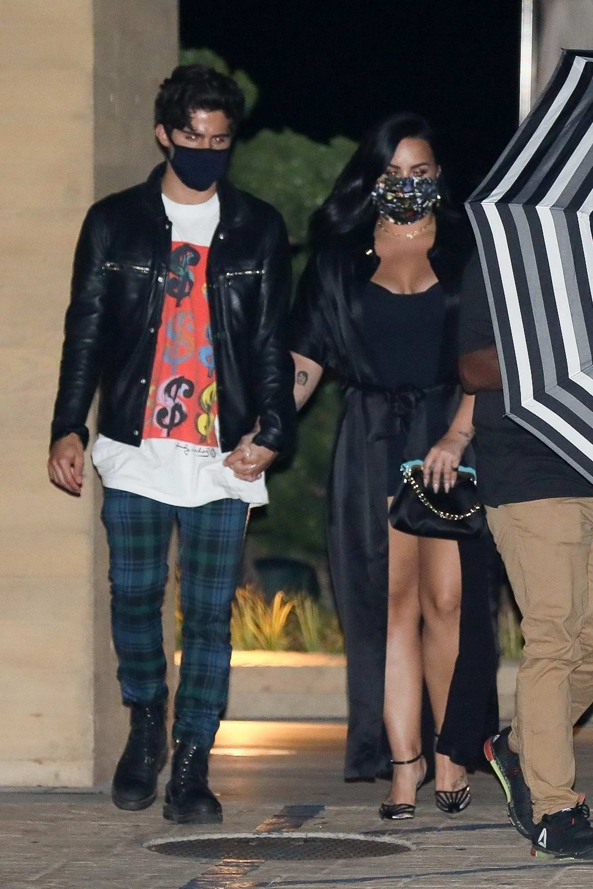 Demi Lovato and Max Ehrich step out for a dinner date at Nobu in Malibu, California