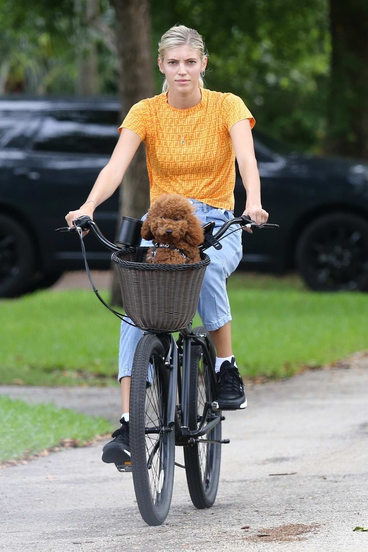 Devon Windsor enjoys a bicycle ride with her pooch in Miami, Florida