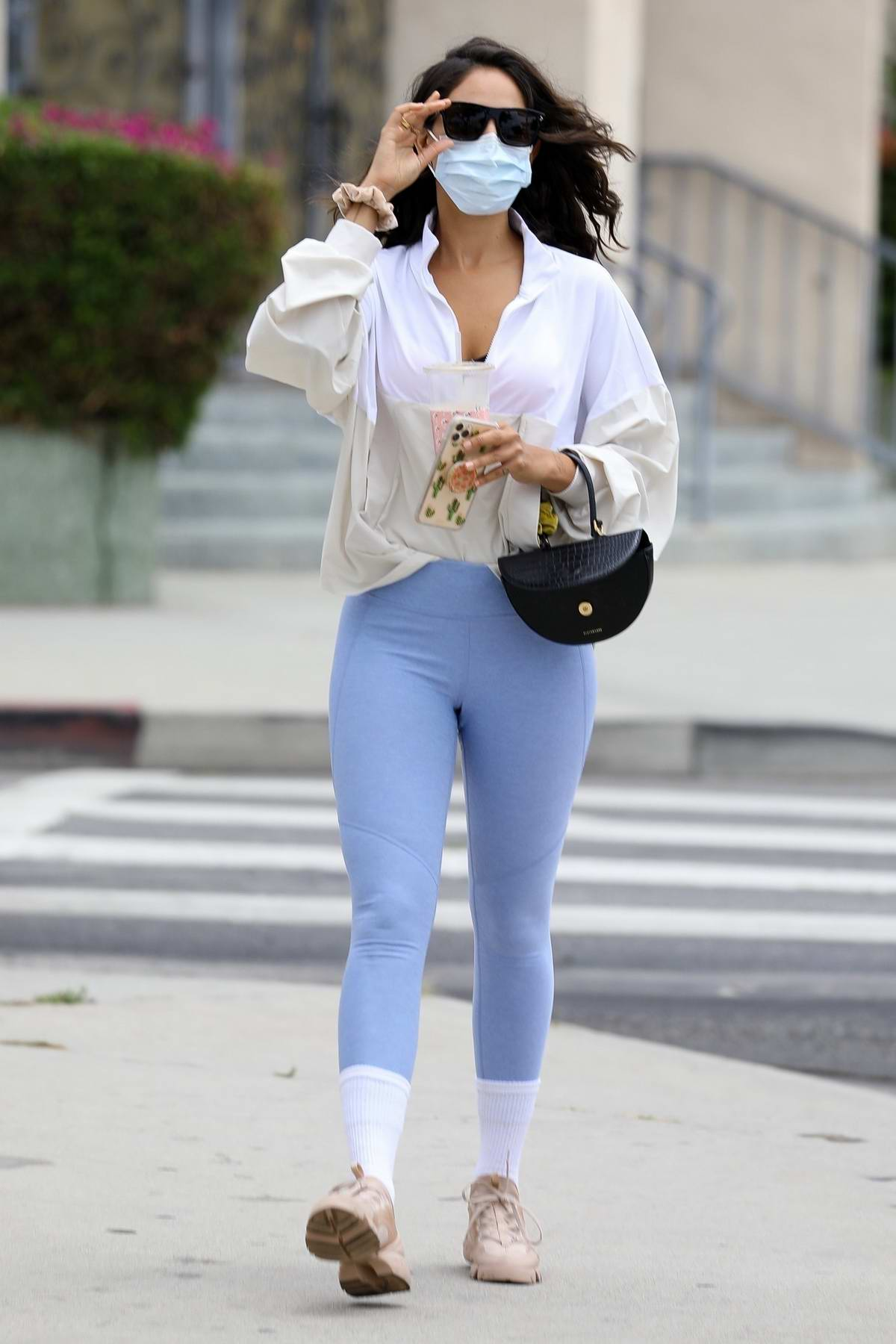 Eiza Gonzalez looks fab in a white shirt and blue leggings as she heads for a lunch date with her friends in Los Angeles