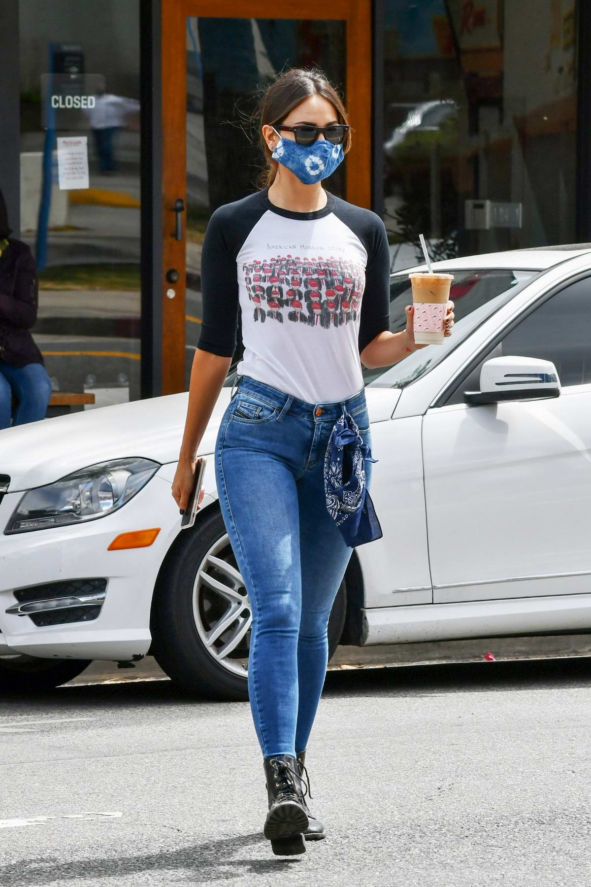 Eiza Gonzalez rocks skinny jeans with a black and white top as she steps out for coffee in Los Angeles