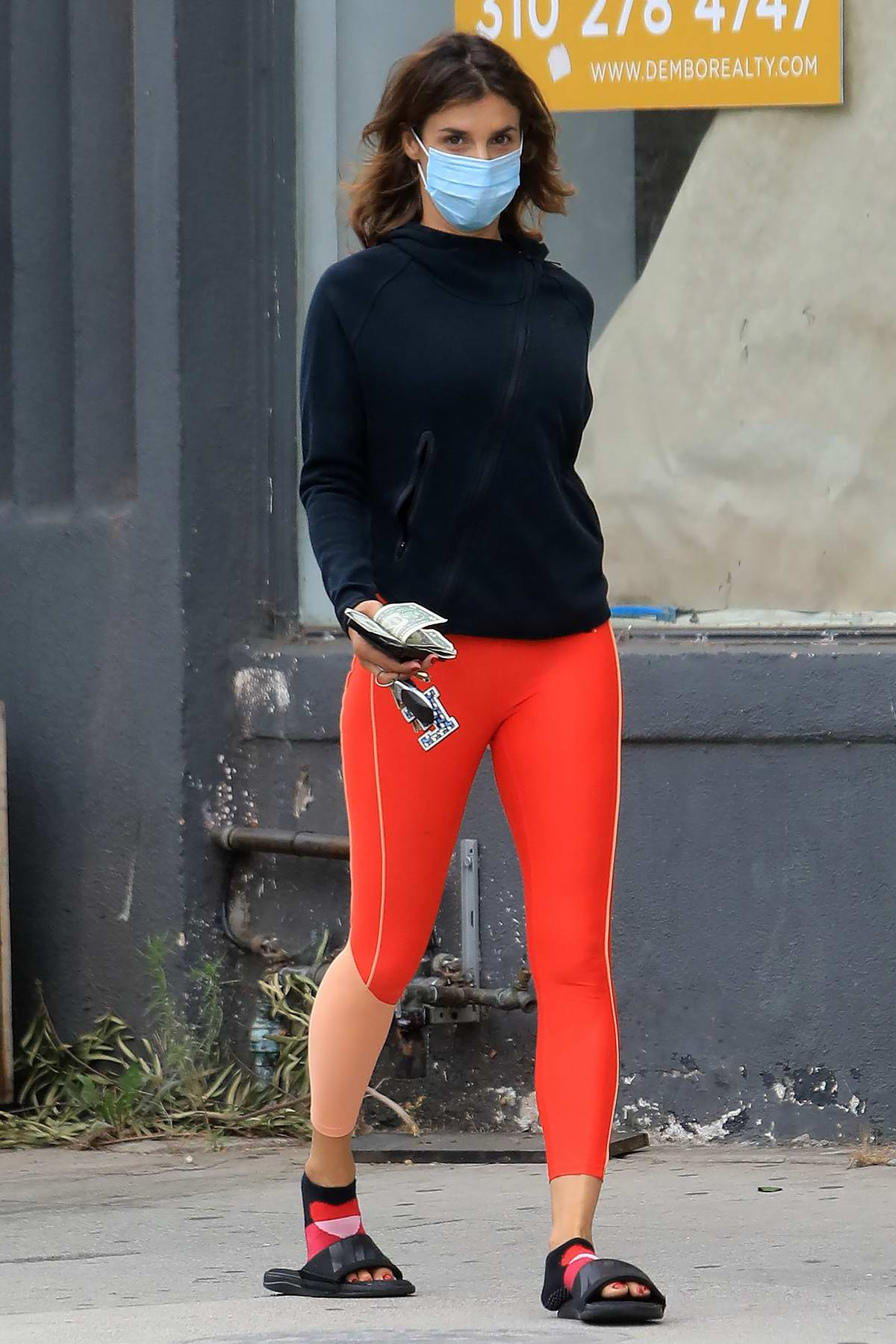 Elisabetta Canalis stands out in bright orange leggings while making a juice run in Los Angeles