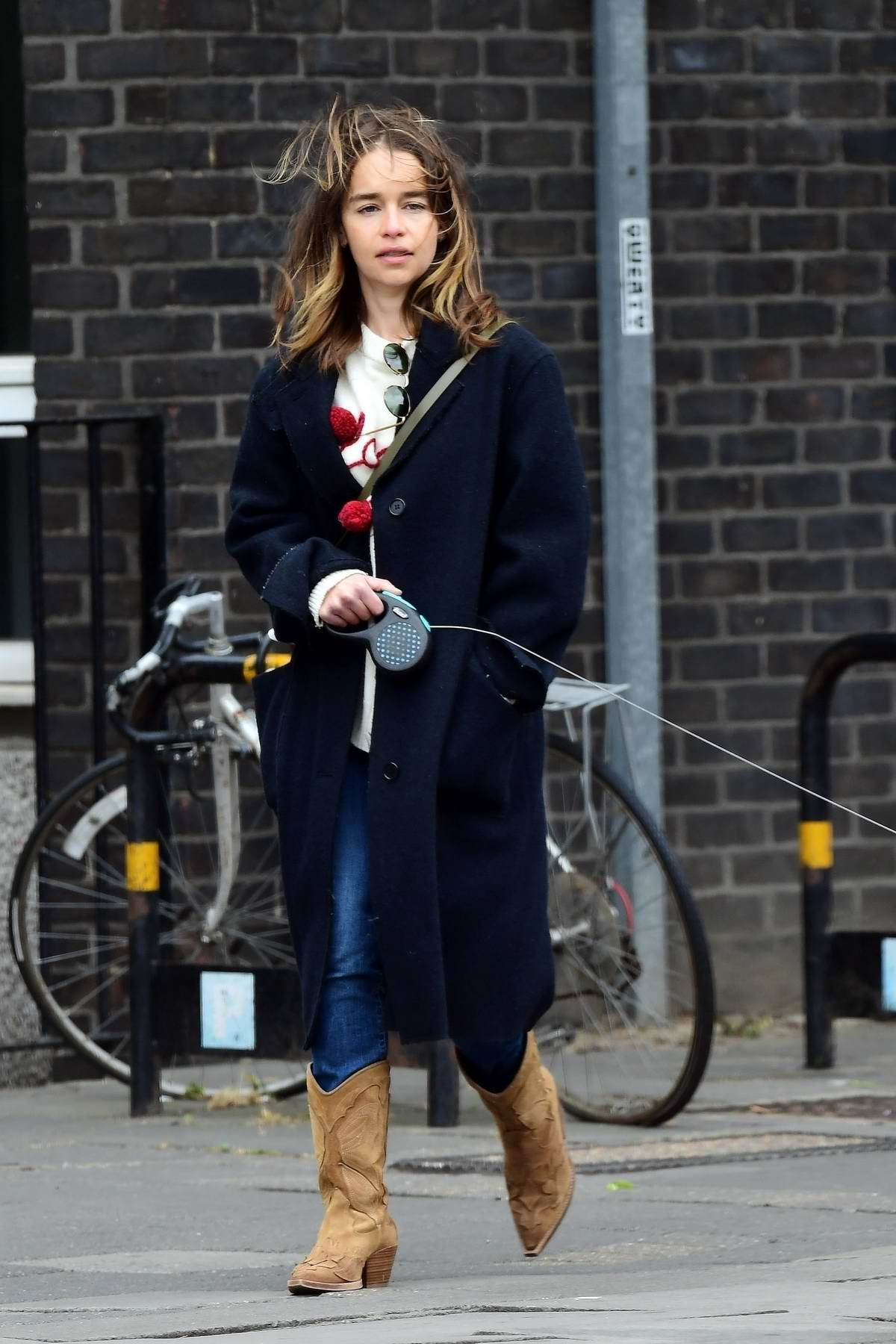 Emilia Clarke steps out for a walk with her dog at a local park in London, UK