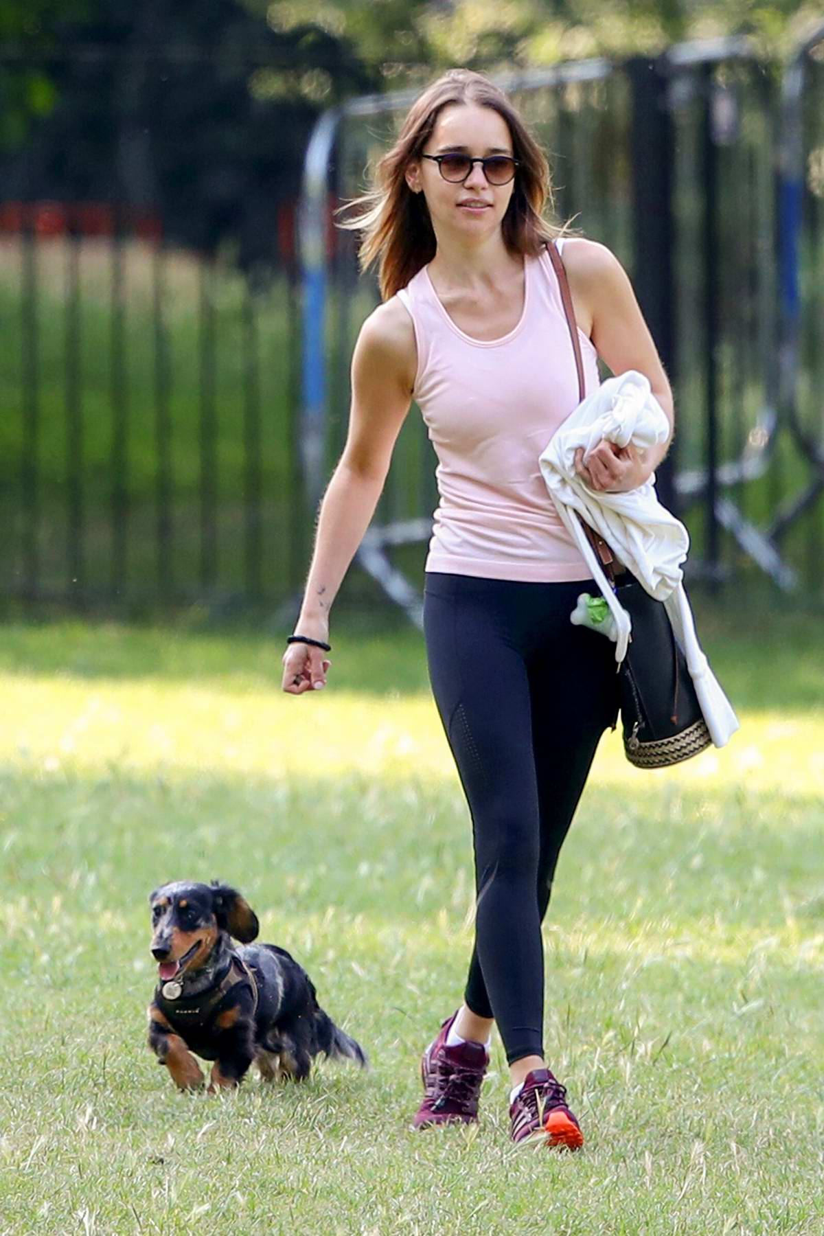 Emilia Clarke takes her dog out to a local park in London, UK