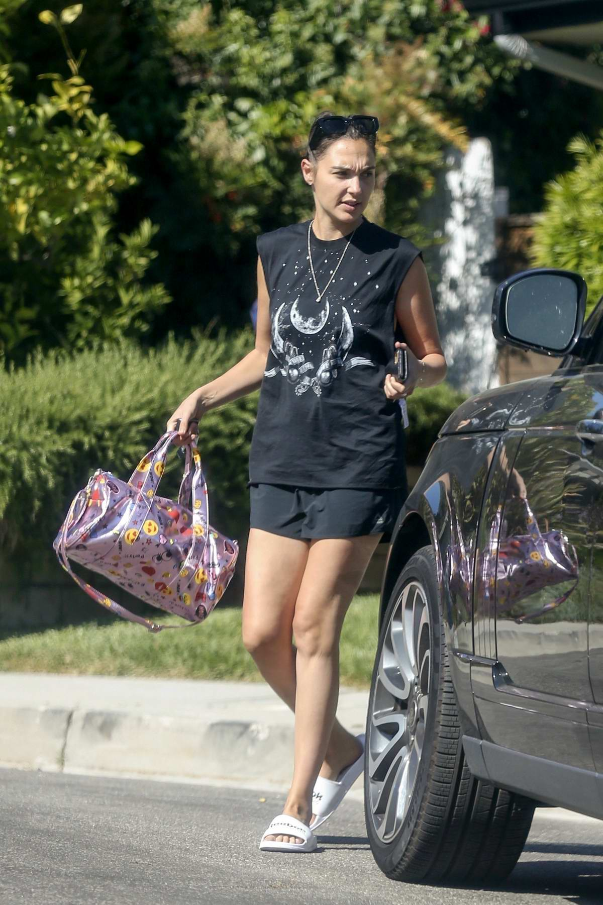 Gal Gadot keeps things casual in a tank top and shorts while heading out in Los Angeles