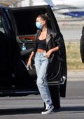Hailey Bieber arrives back from Sardinia on a private jet, Los Angeles