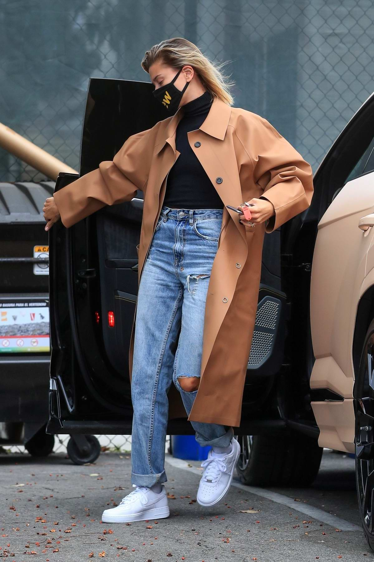 Hailey Bieber looks stylish in a tan long coat as she arrives at a studio in Studio City, California