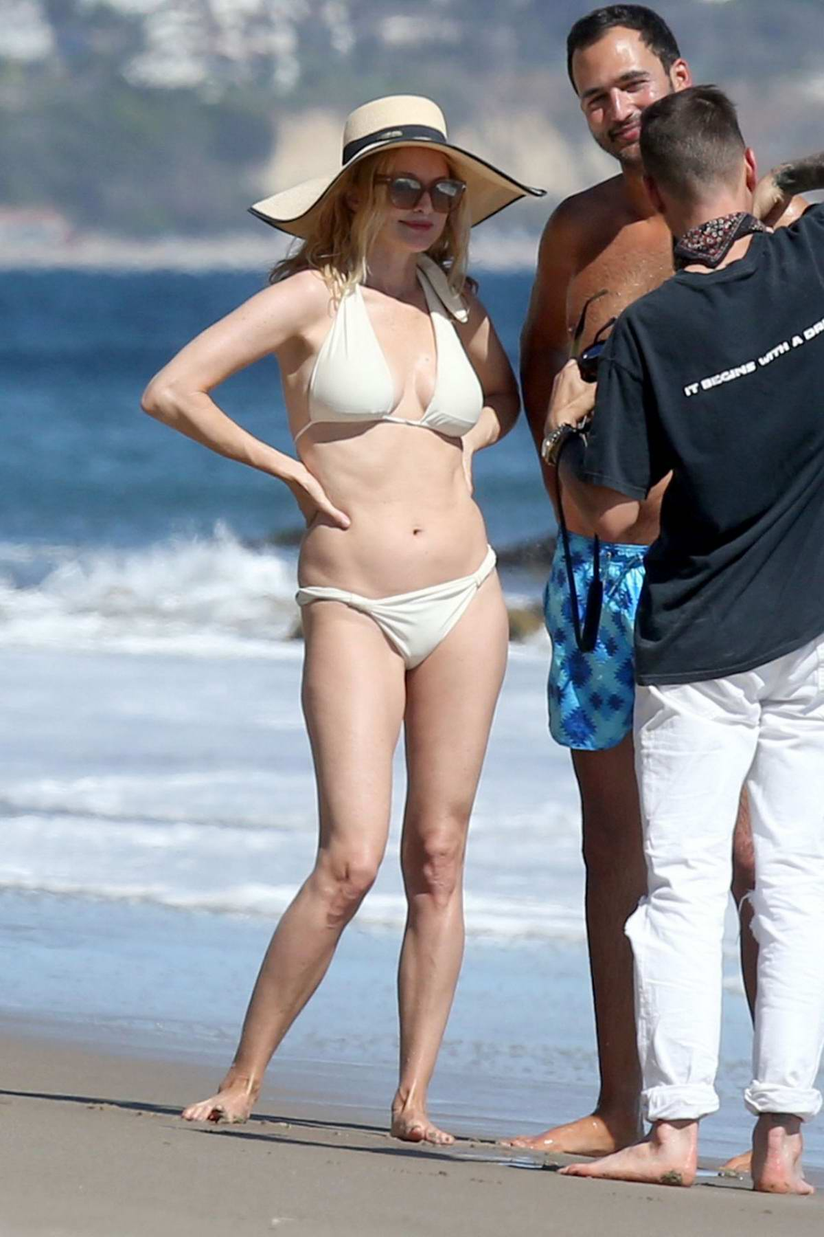 Heather Graham looks amazing in a white bikini as she hits the beach in Malibu, California
