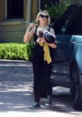 Holly Madison dons all-black while visiting a friend's house in Los Angeles