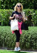 Holly Madison wears a vintage t-shirt and leggings while visiting a friend in West Hollywood, California