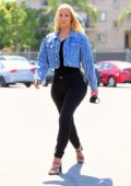 Iggy Azalea makes her first public appearance since giving birth to a baby boy as she steps out to visit the DMV in Los Angeles