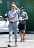 Ireland Baldwin wears a tie-dye top and sweatpants as she steps out for lunch with a friend in Van Nuys, California