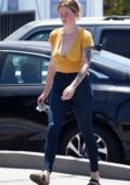 Ireland Baldwin wears a yellow plunging top and skinny jeans while out in Los Angeles