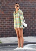 Irina Shayk displays her perfect legs as she steps out wearing a plaid shirt in New York City