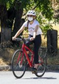 Isla Fisher sports an 'Alpha Female' tee and leggings while out riding her bike in Los Angeles