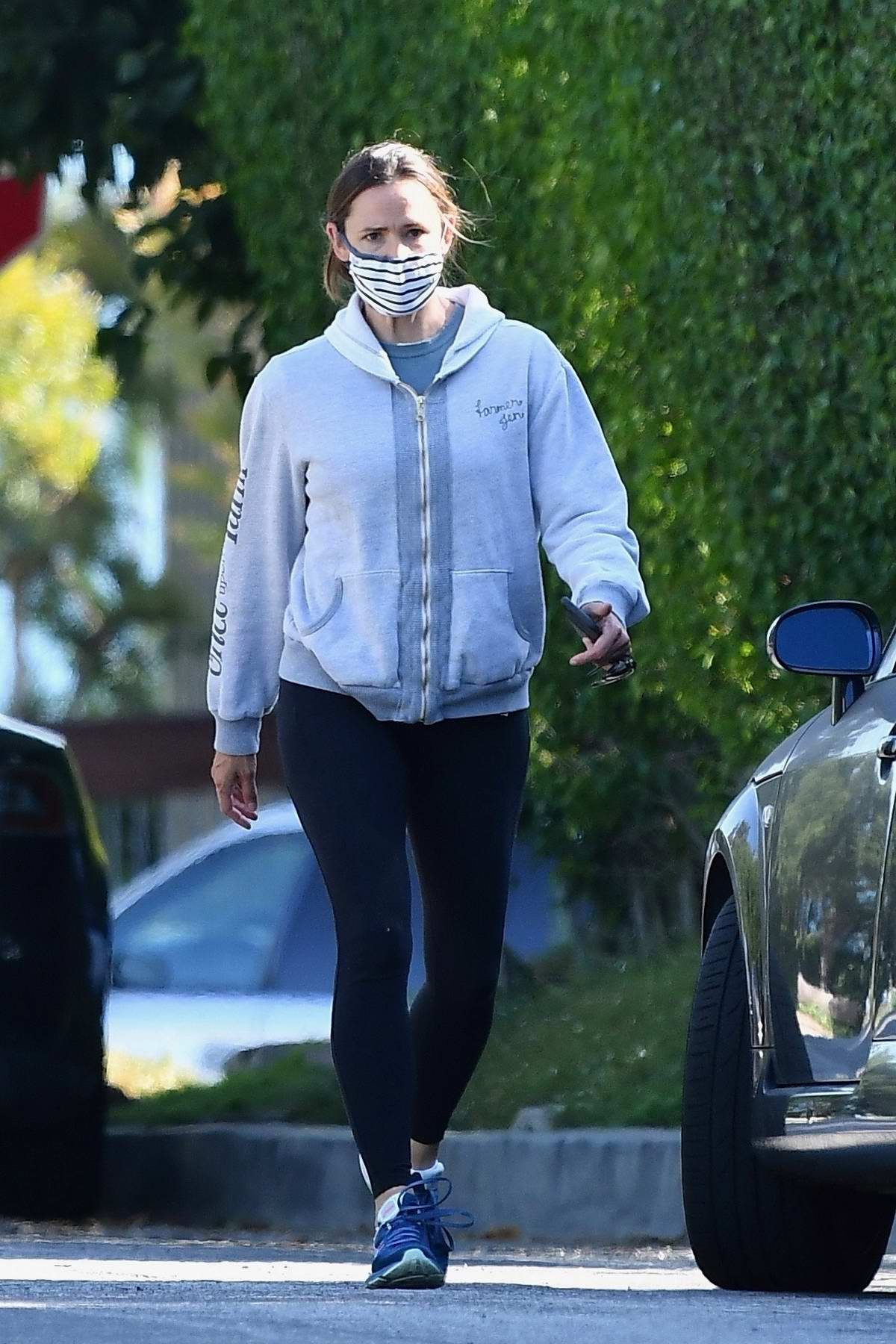 Jennifer Garner wears a grey hoodie and black leggings while out for an afternoon hike with a friend in Los Angeles