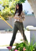 Jessica Gomes covers her face with a black bandana during an outing in West Hollywood, California